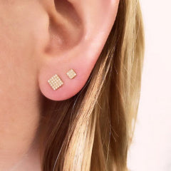 large square post earrings on ear