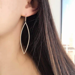 open elongated marquise earrings on ear