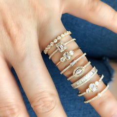 a selection of Liven's diamond bands including the bezel set diamond eternity band