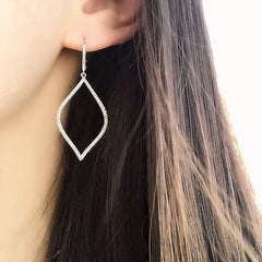 open marquise earrings on ear