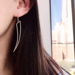 open horn earrings on ear
