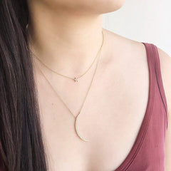star pave choker layered wiht other necklaces
