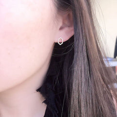 open hexagon post earrings on ear