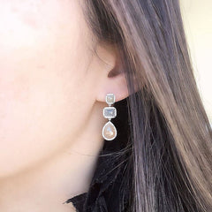 one of a kind rustic diamond earrings on ear