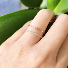 Single Petite Bezel Set Diamond Band on hand