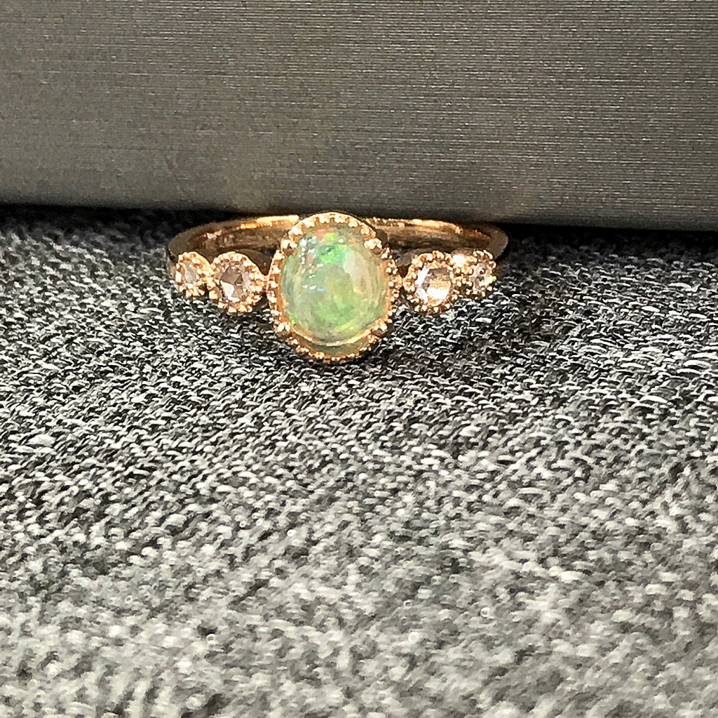 rose cut one of a kind opal, set in 14k rose gold, bracketed with graduated rose cut diamonds