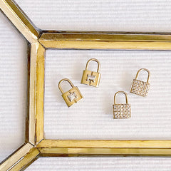 padlock charms in gold with diamonds
