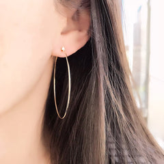 50mm Souli hoops with diamonds at the top in 14k yellow gold on ear