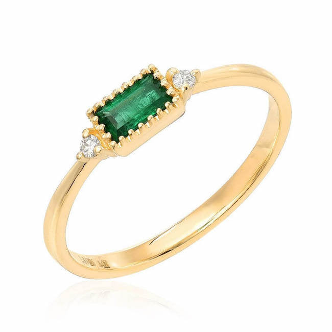 emerald baguette ring in yellow gold