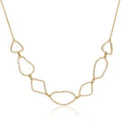 organic shape necklace with diamonds in yellow gold