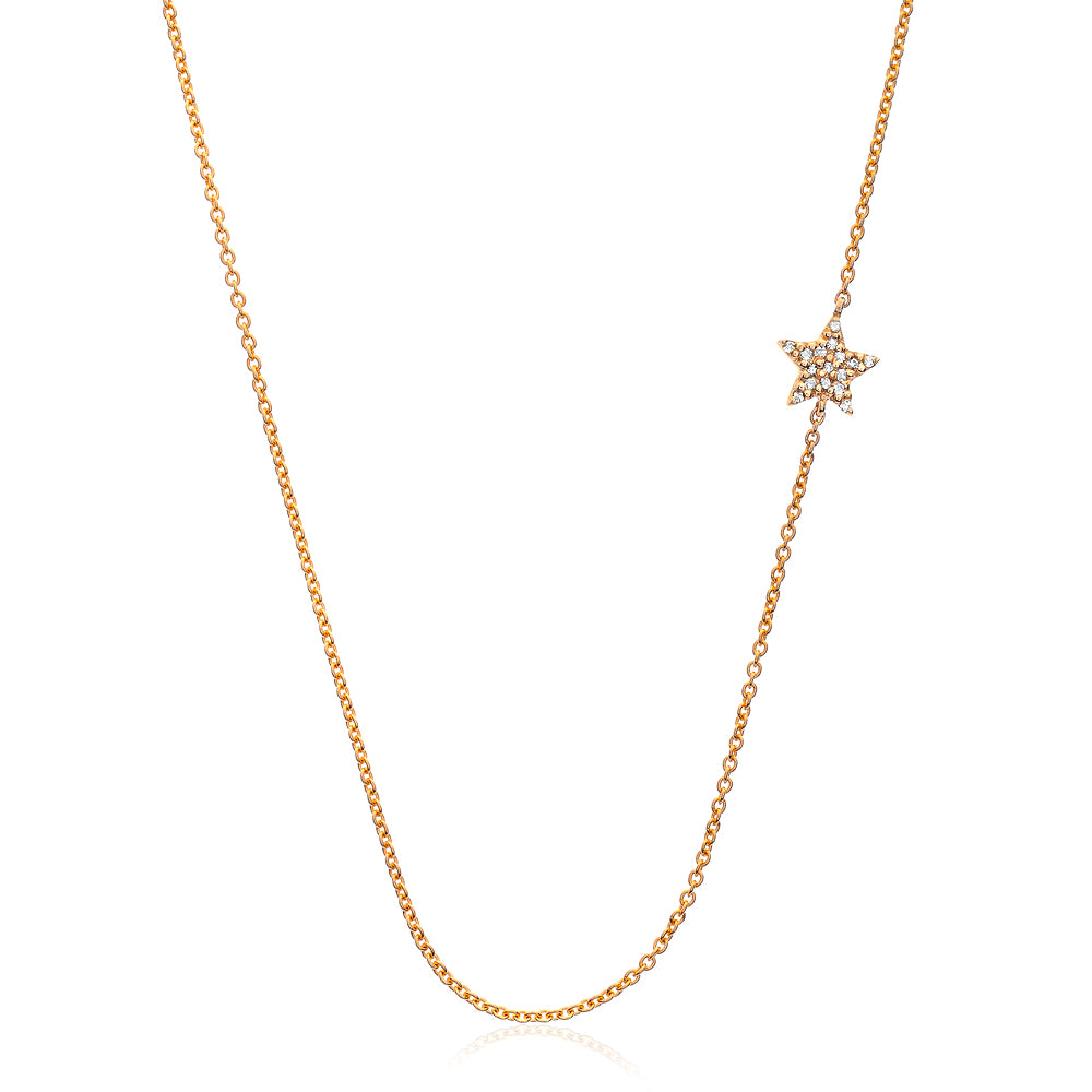 sideways star necklace with diamonds in yellow gold