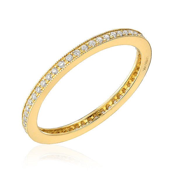 pave eternity band with milgrain border in yellow gold