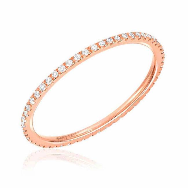 thin diamond eternity band with diamonds in rose gold