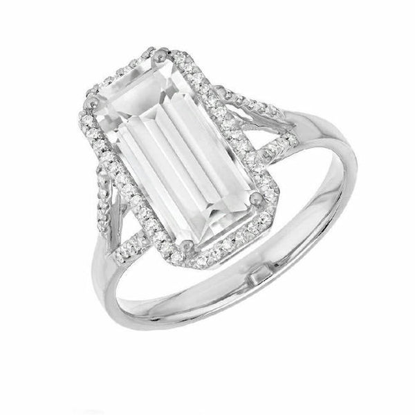 Emerald cut white topaz ring in white gold