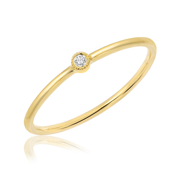 Single Petite Bezel Set Diamond Band in yellow gold