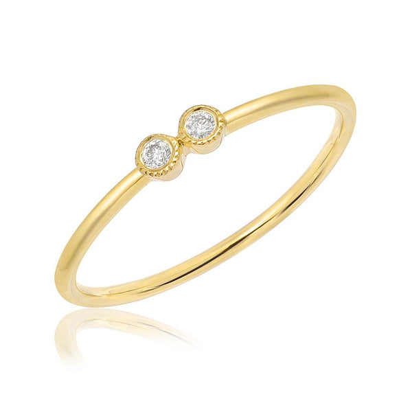 double petite bezel set diamond band in yellow gold