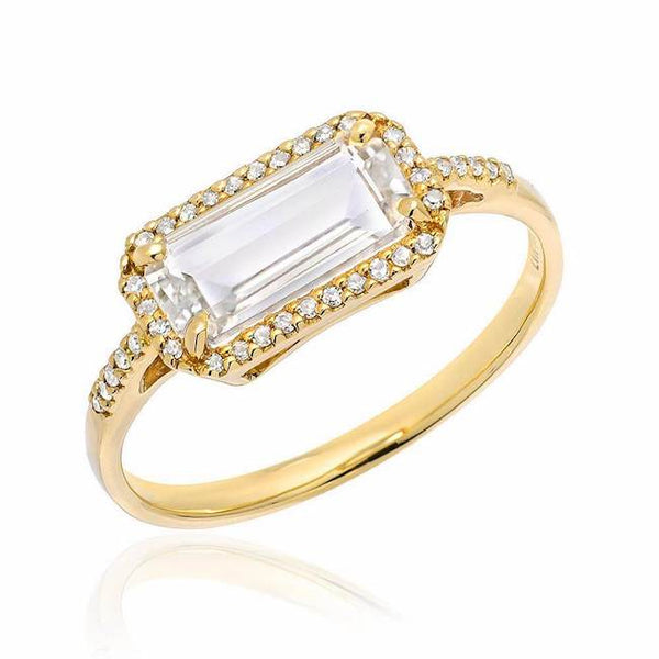 east west emerald cut white topaz ring in yellow gold