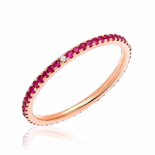 Ruby eternity band with compass point diamonds in rose gold