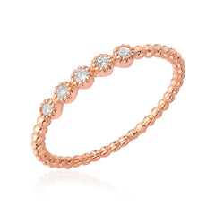 beaded band with 5 bezel set diamonds in rose gold