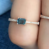 rose gold diamond band with emerald cut london blue topaz