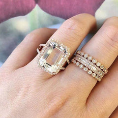 Emerald cut white topaz ring on hand