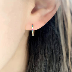 rainbow sapphire and diamond huggies on ear