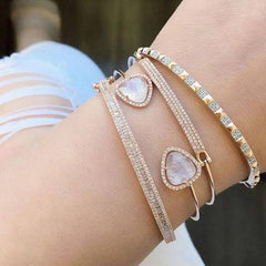 Diamond bar bangle stacked with other bangles
