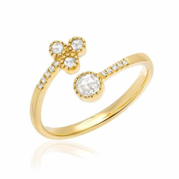 four rose cut diamond twist ring in yellow gold