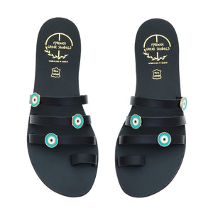 Black leather sandals with evil eye embellishments