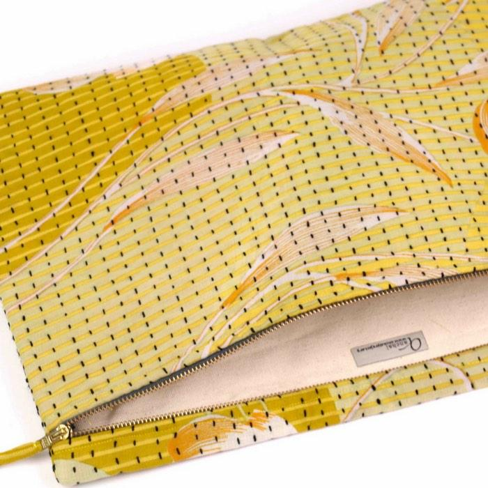 Handcrafted from layers of vintage cotton fabric with a cotton canvas lining, ethical sustainable clutch bag