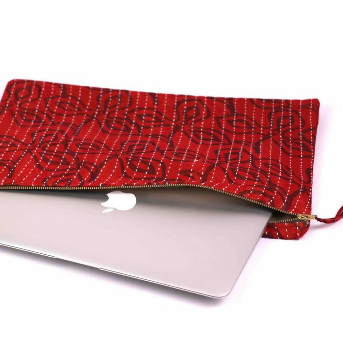 One of a kind unique laptop case that can also be multi-purposed as a clutch bag