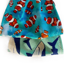 Load image into Gallery viewer, Reversible Youth face mask cover Clown fish on one side and sharks on the other