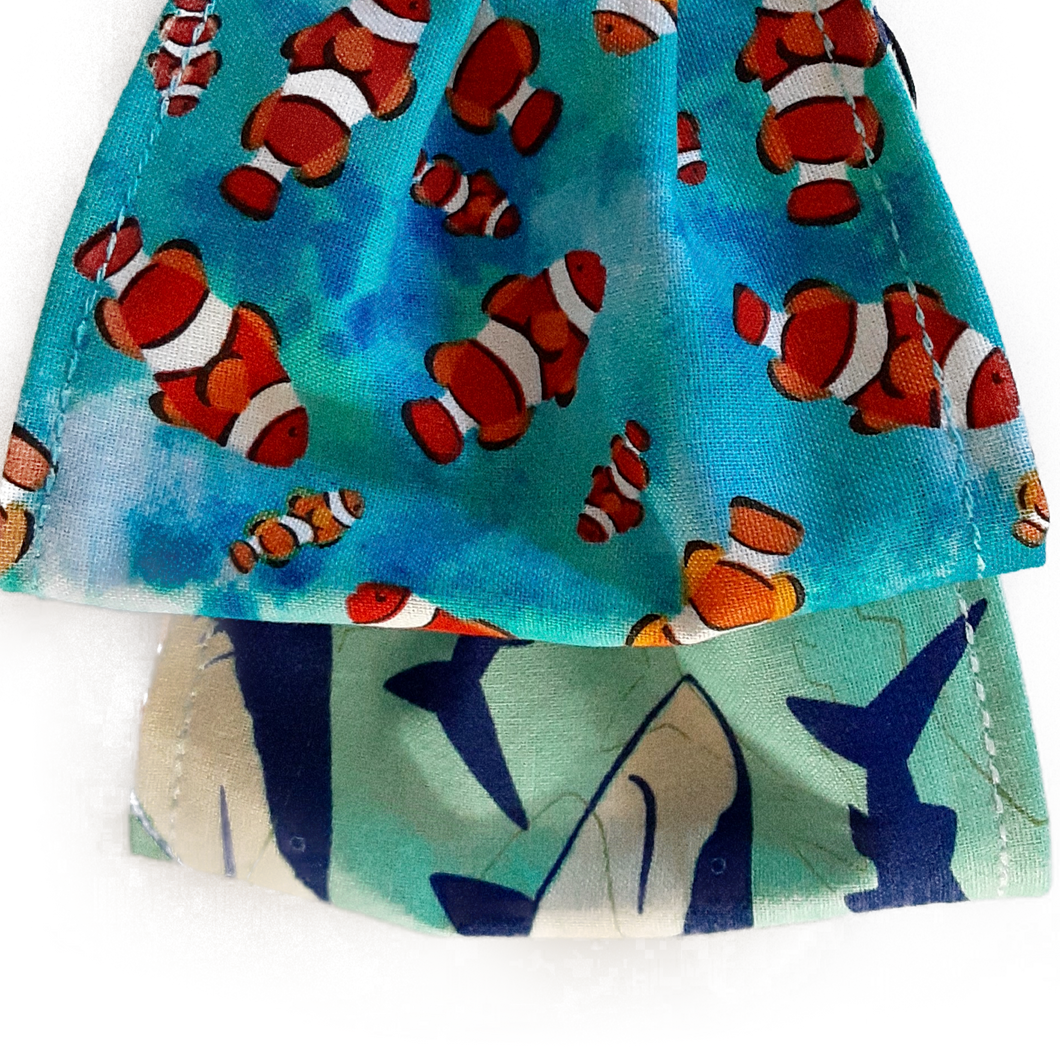 Reversible Youth face mask cover Clown fish on one side and sharks on the other