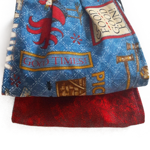 **This is 1 face cover with a reversible pattern: Picnic Scene on one side and Red Pattern on the other.