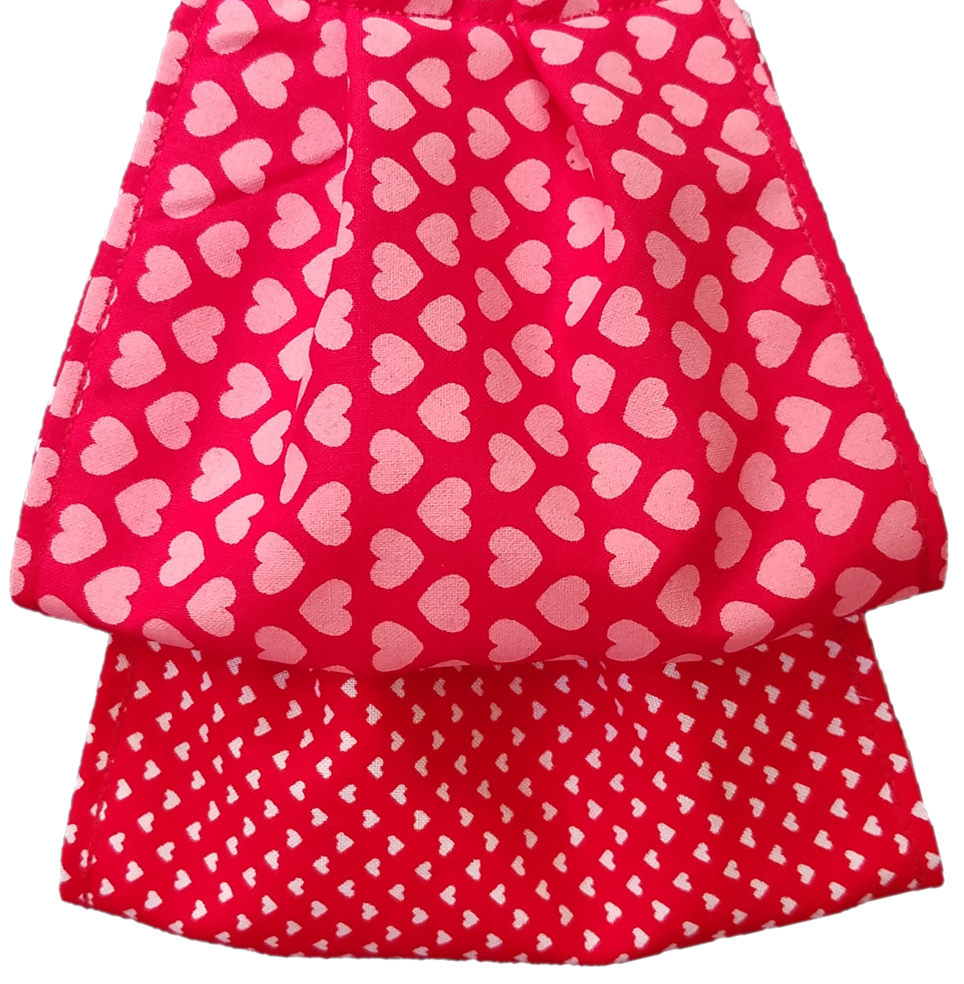 This is a newly handmade cotton adult fabric face cover. This is double ply, reusable and washable. Made in the USA.  This can be used as a public courtesy cover.   **This is 1 face cover with a reversible pattern: It is Red with Hearts on one side and Red with White Hearts on the other