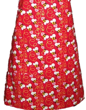 Load image into Gallery viewer, Red apron with bees and swirls and sweetheart candies with the words Bee Mine on it