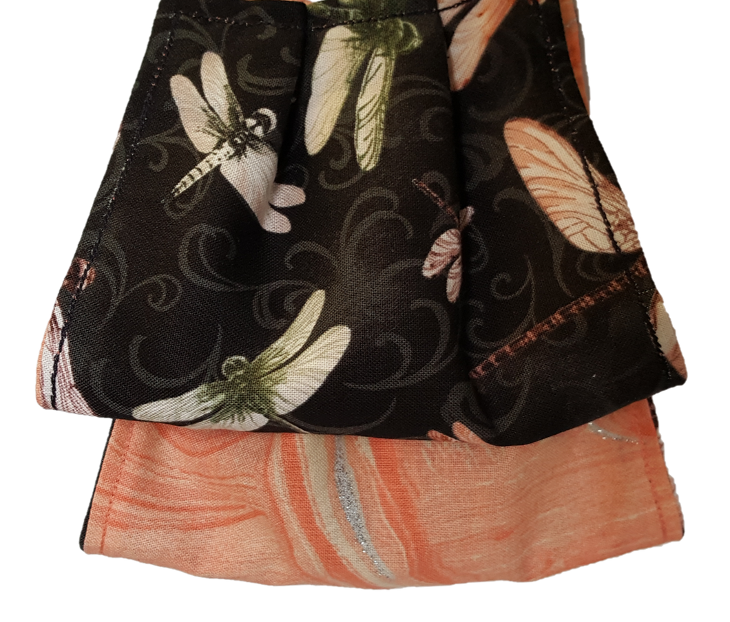 **This is 1 face cover with a reversible pattern: Dragonfly's in different colors on one side and Peach hues on the other.  **This face cover does not guarantee protection from disease.  You must wash before using. Stay safe and be well.