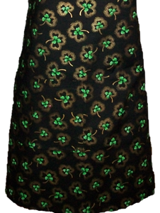 "This is a new handmade bib apron. The fabric is cotton. It is Black with Gold and Green Shamrocks on it. It has one right hand pocket. It measures approx. 27""-28"" from neck edge to bottom hem and 31.5"" from side to side. The bib is approx. 10.5"" wide. The neck strap is 20"" long total and the side ties are approx. 27""-28"" long. Nice gift for someone cooking your special meal, or you can just be cooking cute!"