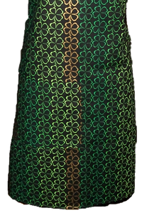 "This is a new handmade bib apron. The fabric is cotton. It is Black with 4 Leaf Clovers in different shades of Green and Gold on it. It has one right hand pocket. It measures approx. 27""-28"" from neck edge to bottom hem and 31.5"" from side to side. The bib is approx. 10.5"" wide. The neck strap is 20"" long total and the side ties are approx. 27""-28"" long. Nice gift for someone cooking your special meal, or you can just be cooking cute!"