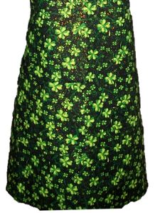 "This is a new handmade bib apron. The fabric is cotton. It is Black with Green 4 Leaf Clovers and Gold Sparkles on it. It has one right hand pocket. It measures approx. 27""-28"" from neck edge to bottom hem and 31.5"" from side to side. The bib is approx. 10.5"" wide. The neck strap is 20"" long total and the side ties are approx. 27""-28"" long. Nice gift for someone cooking your special meal, or you can just be cooking cute!  Note - This Apron has sparkles on it that may rub off, not suitable for food service"