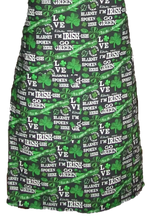 "Load image into Gallery viewer, This is a new handmade bib apron. The fabric is cotton. It is Black with Green Shamrocks, 4 Leaf Clovers, and various Sayings on it such as ""Kiss me I'm Irish"". It has one right hand pocket. It measures approx. 27""-28"" from neck edge to bottom hem and 31.5"" from side to side. The bib is approx. 10.5"" wide. The neck strap is 20"" long total and the side ties are approx. 27""-28"" long. Nice gift for someone cooking your special meal, or you can just be cooking cute!"