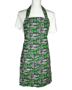 "This is a new handmade bib apron. The fabric is cotton. It is Black with Green Shamrocks, 4 Leaf Clovers, and various Sayings on it such as ""Kiss me I'm Irish"". It has one right hand pocket. It measures approx. 27""-28"" from neck edge to bottom hem and 31.5"" from side to side. The bib is approx. 10.5"" wide. The neck strap is 20"" long total and the side ties are approx. 27""-28"" long. Nice gift for someone cooking your special meal, or you can just be cooking cute!"
