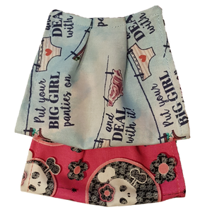 "**This is 1 face cover with a reversible pattern: ""put your big girl panties on and deal with it"" saying on one side and Pink with skulls on the other."