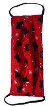 Load image into Gallery viewer, This is 1 face cover with a reversible pattern: It is Red with Dogs wearing Santa Hats on one side and Black with Red and White Candy Canes on the other
