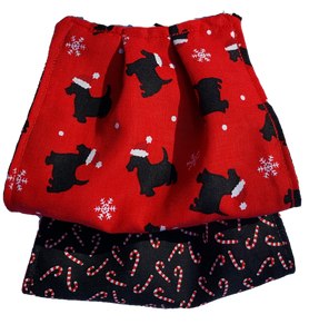 This is 1 face cover with a reversible pattern: It is Red with Dogs wearing Santa Hats on one side and Black with Red and White Candy Canes on the other