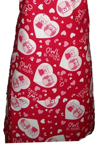 "This is a new handmade bib apron. The fabric is cotton. It is Red with Love Owls in a heart, Hearts and a saying ""Owl be yours"" on it. It has one right hand pocket. It measures approx. 27""-28"" from neck edge to bottom hem and 31.5"" from side to side. The bib is approx. 10.5"" wide. The neck strap is 20"" long total and the side ties are approx. 27""-28"" long. Nice gift for someone cooking your special meal, or you can just be cooking cute!"
