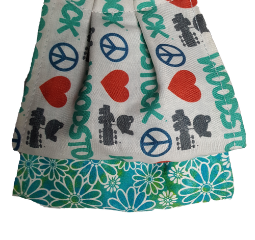 **This is 1 face cover with a reversible pattern: Woodstock, Peace and love signs on one side and Teal with white flowers on the other.  **This face cover does not guarantee protection from disease.  You must wash before using. Stay safe and be well.