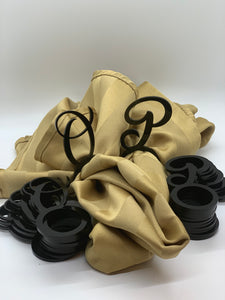 black acrylic letter P and O napkin rings