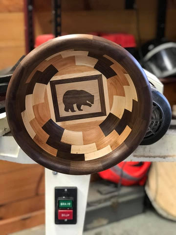 Wood turned bowl featuring Walnut wood inlay created by woodturner in woodshop using Forest 2 Home premium hardwood lumber