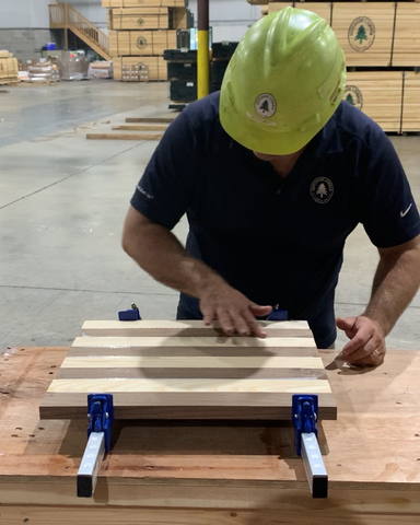 Woodworker gluing up woodworking project DIY chess board in Forest 2 Home woodwork shop with wood glue and Shop F2H Ash wood and Walnut wood